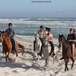 Horse riding on the sand at Pearly Beach
