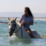 Horse Riding in the water at Pearly Beach