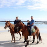 Family horse riding at Pearly Beach
